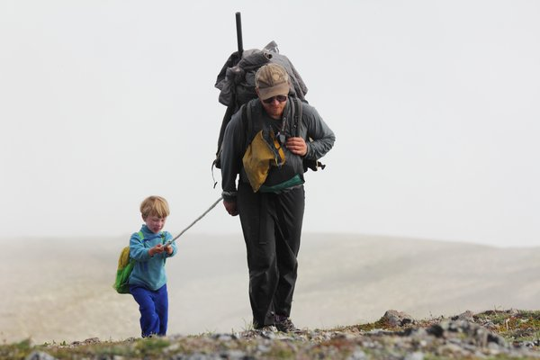 Katmai gets a boost from dad going up the mountain.