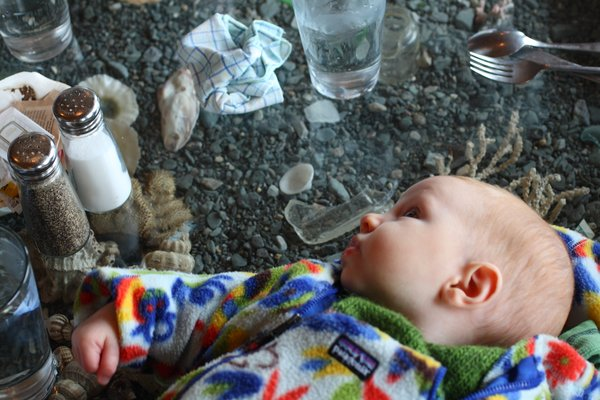 At the tidepool restaurant, the table provides a handy spot to put the baby