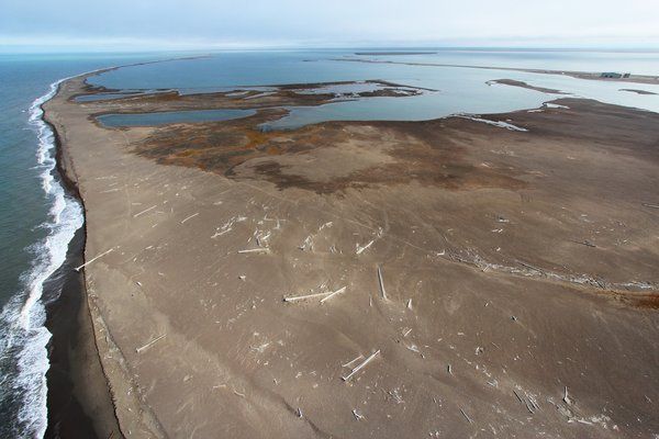 Alaska's arctic coast is largely fringed by long barrier spits that are overwashed by storms.