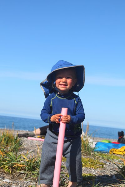 On beach with my pink walk stick