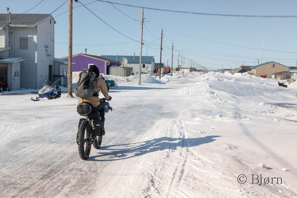 The village of Shaktoolik sits atop a berm on the eastern shore of Norton Sound. Kim rides down the only street of this beautiful and stark community.