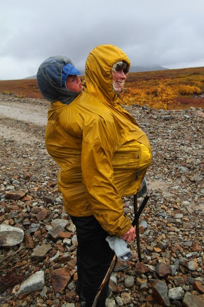 Erin stretched her coat around Katmai, her pregnant belly, and her front pouch.