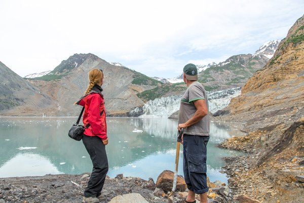 Marten Geertsema and Anja Dufresne, landslide experts, pause from their work to watch the Tyndall Glacier calve into Taan Fjord. Martin and Anja spent several days in the summer of 2016 investigating the landslide debris in Taan Fjord.