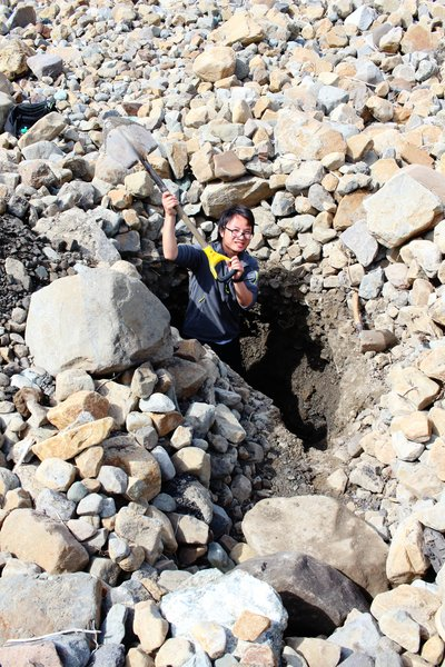 Hui Tang helps excavate a hole into sediment deposited by the 17 Oct 2015 tsunami in Taan Fjord.