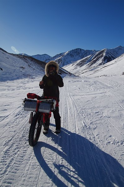 Kim nearing the summit of Rainy Pass on the Iditarod Trail. The proposed natural gas pipeline to supply <a href=http://www.alaskadispatch.com/article/donlin-mine-moves-slowly-toward-reality>power to the mine</a> would pass through this corridor.