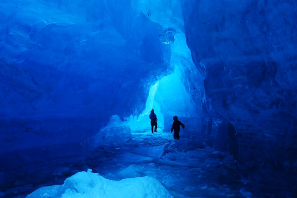 Erin and Lituya explore caves in the front of Grewingk Glacier.