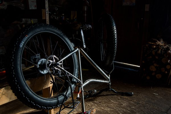 After hundreds of miles and daily use Bjørn's fat-bike needed some attention. Thankfully Tripod Flats shelter cabin was available for the travelers to do the necessary gear repairs in.