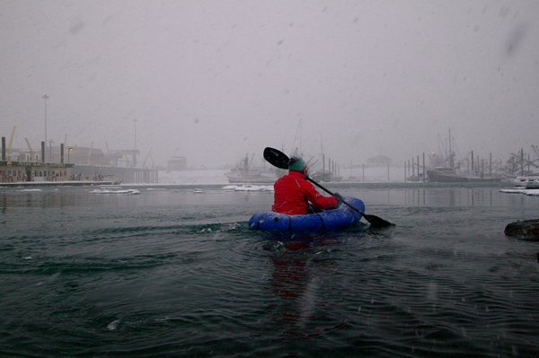 Paddling into the Homer boat harbor.