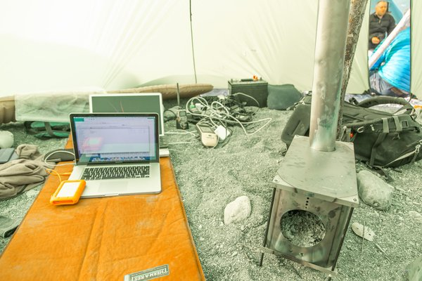 Expensive, and often state of the art, technology was employed to document, map, and study the landslide generated tsunami, in Taan Fjord, Alaska, which occurred in October 2015. Three successful expeditions were undertaken,  in the summer of 2016, to study the event. This battery charging shelter was warmed with a small, light-weight, titanium wood stove.