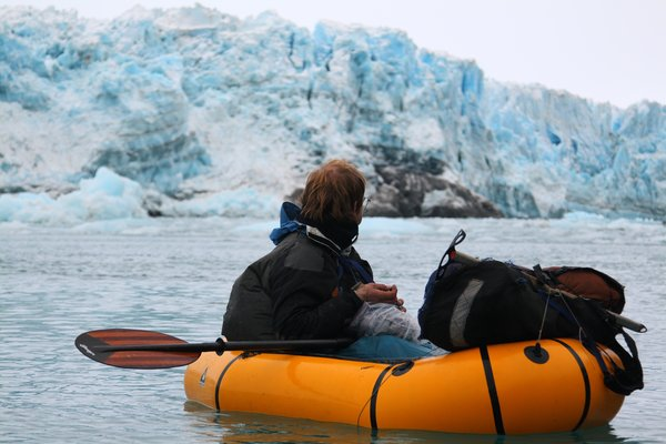 "Just after squeezing through the narrow gap <a href=""http://www.groundtruthtrekking.org/Journeys/WildCoast.html"">between the calving glacier and steep cliff</a>, Hig pauses to eat a gift dropped by a kindly Yakutat pilot."