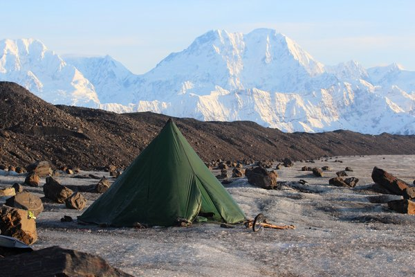 Far from the glacier edge, we camped on a patch of mud large enough to partially protect our bed from the icy chill of the glacier.  Blue ice all around lit the inside of the tent with a bizarre glow.