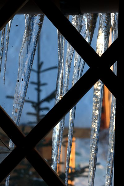 Icicles decorate the windows of the yurt.