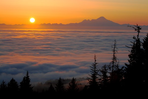 Sunset over a blanket of fog in Cook Inlet