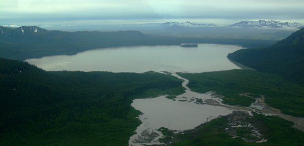 An aerial view of Kushtaka Lake, looking out over the Bering River Delta
