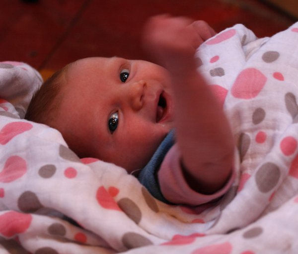 4 weeks old, Lituya gives one of her first smiles along with a fist pump