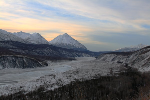 Gravel, ice, and willow floodplains make up the frozen Matanuska River.