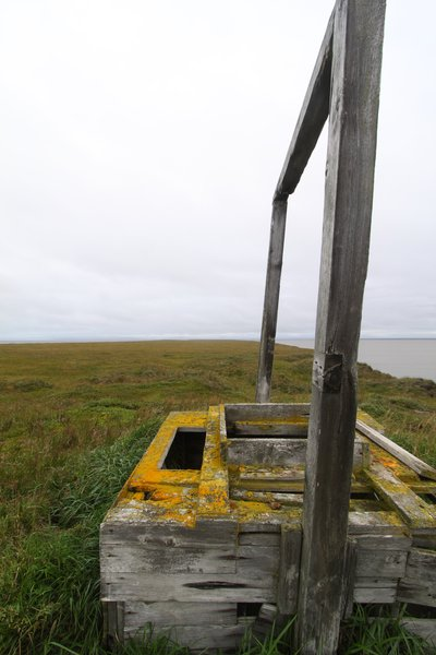 These photos depict signs of permafrost melting and coastal erosion.