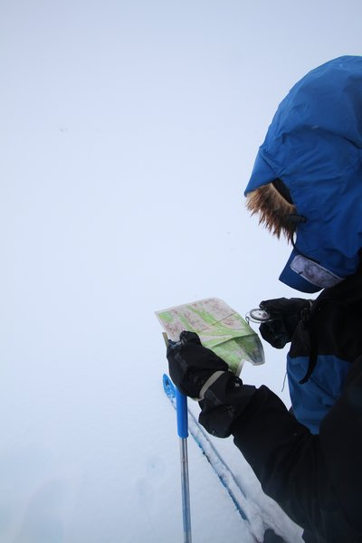 The compass is often reserved for whiteouts, but USGS topo maps, printed out on waterproof paper, are our main aid to navigation