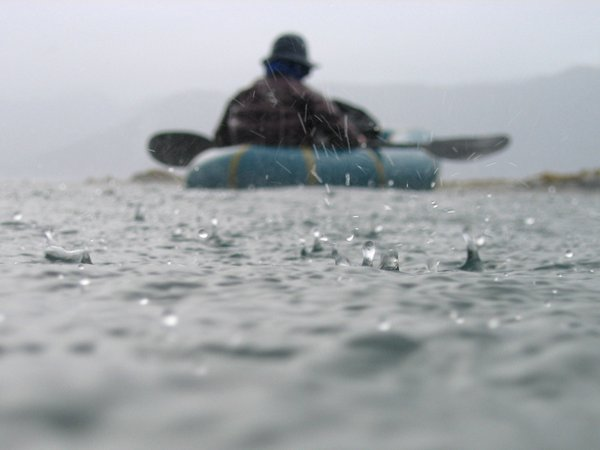 packraft in the rain in Prince William Sound