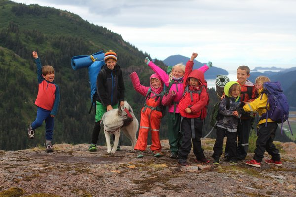 Kids pose on Lunch Mountain, celebrating their backpack trip on the new Tutka trail