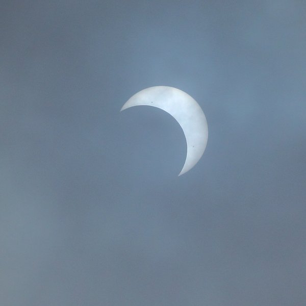 Clouds allowed us to see the sun directly, a glimpse of eclipse before grey covered it up again.