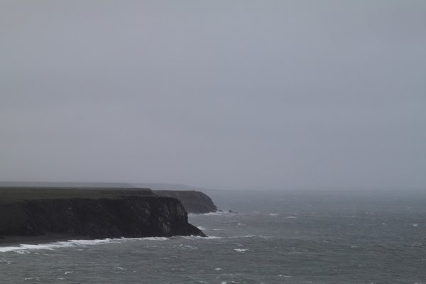 Hard wind drives waves against cliffs on the Chukchi Sea.