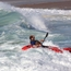 Surfing a heavy packraft