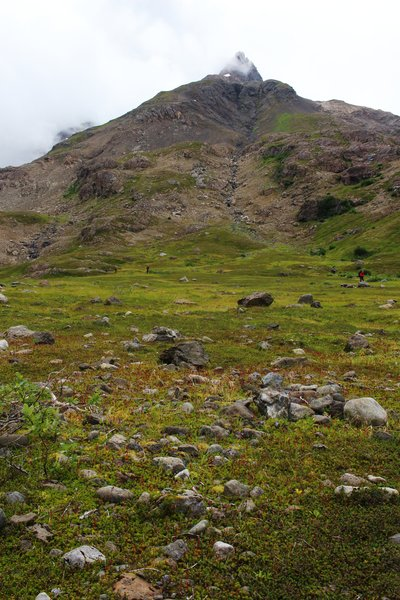 The boulder-littered tundra meadows here high in Tutka Valley provide ample camping even for a large group.
