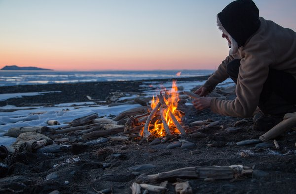 Kim and Bjørn enjoy sleeping out on the Norton Sound coast with a warm fire and beautiful sunset